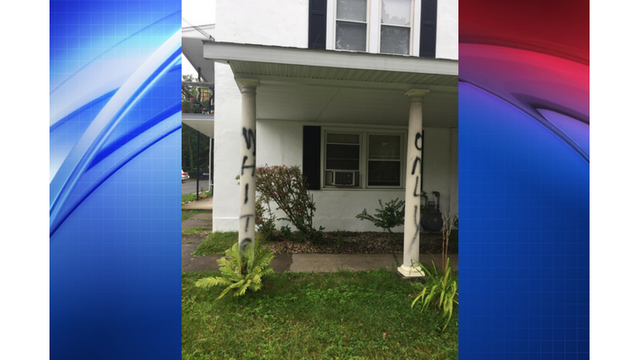 'White Only' spray painted on South Glens Falls apartment building