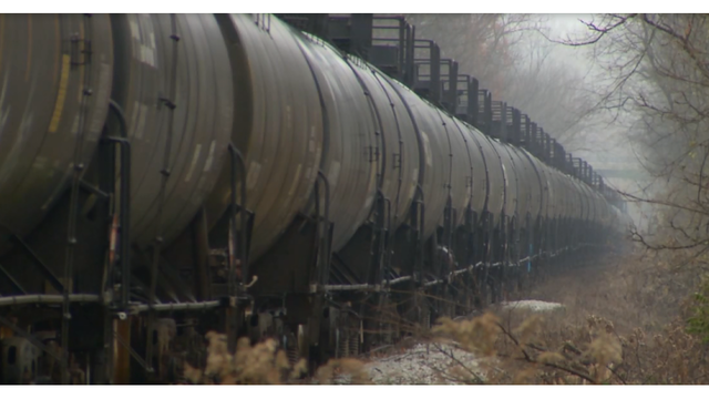 Propane-filled train cars parked on tracks in Bennington